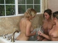 Three hot big tits lesbians having fun in tub