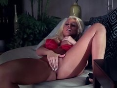 Blonde in satin bra plays with her pussy