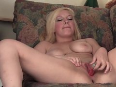Hot mature mom satisfying herself by a dildo