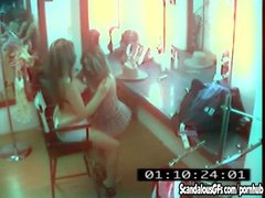 Two brunettes having sex in parlor