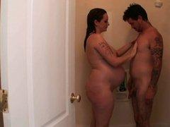 Pregnant slut showing off with boyfriend